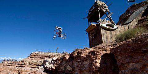 Motorcycle, Soil, Motocross, Stunt performer, Motorcycling, Rock, Extreme sport, Bedrock, Enduro, Stunt,