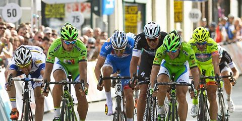 Clothing, Tire, Wheel, Bicycles--Equipment and supplies, Bicycle helmet, Bicycle wheel, Human, Bicycle jersey, Bicycle tire, Land vehicle,
