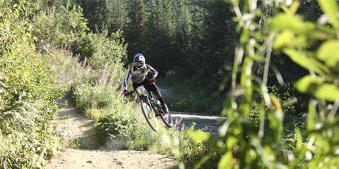 Clothing, Bicycle frame, Mountain bike, Helmet, Sports equipment, Mountain biking, Bicycle helmet, Bicycle wheel, Bicycles--Equipment and supplies, Downhill mountain biking,