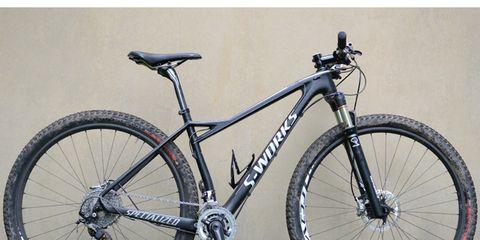 Bicycle tire, Bicycle frame, Bicycle wheel, Tire, Wheel, Bicycle fork, Bicycle wheel rim, Bicycle part, Bicycle handlebar, Bicycle saddle,