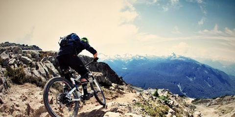 Tire, Wheel, Bicycle wheel, Mountain bike, Mountain biking, Bicycle frame, Sports equipment, Cross-country cycling, Downhill mountain biking, Bicycle,
