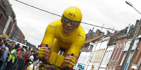 Yellow, Human body, Helmet, Goggles, Sports gear, Personal protective equipment, Logo, Street light, Glove, City car,