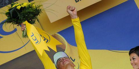 Yellow, Wrist, Logo, Sports jersey, Balance, Cheering, Sleeveless shirt,