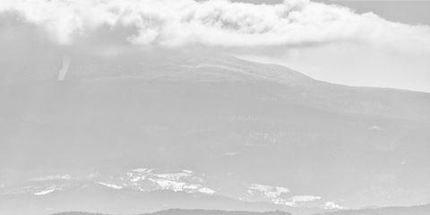 Sky, Cloud, Atmosphere, Highland, Atmospheric phenomenon, Mountain range, Mountain, Monochrome photography, Monochrome, Hill,