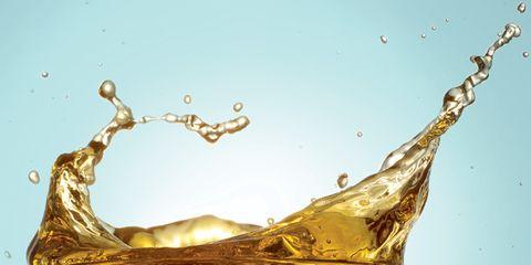 Liquid, Fluid, Yellow, Drop, Amber, Art, Still life photography, Serveware, Oil, Barware,