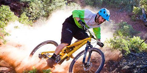 Clothing, Tire, Wheel, Bicycle frame, Bicycle wheel, Mountain bike, Mountain biking, Bicycle, Downhill mountain biking, Bicycle tire,
