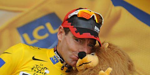 Yellow, Cap, Goggles, Toy, Jersey, Plush, Logo, Stuffed toy, Baseball cap, Fur,