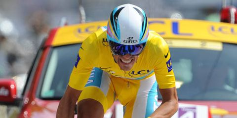 Bicycle handlebar, Bicycle jersey, Bicycles--Equipment and supplies, Yellow, Helmet, Bicycle helmet, Sportswear, Bicycle frame, Sports uniform, Bicycle part,