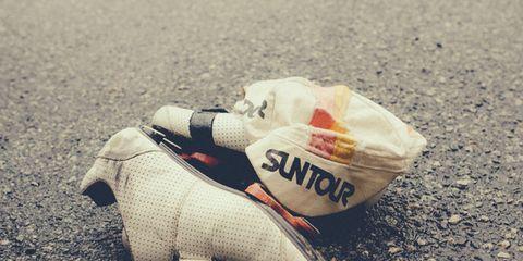 Carmine, Sand, Beige, Litter, Walking shoe, Cross training shoe, Stock photography, Shadow,