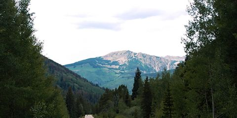 Road, Natural environment, Mountainous landforms, Road surface, Infrastructure, Highland, Asphalt, Natural landscape, Mountain range, Mountain,