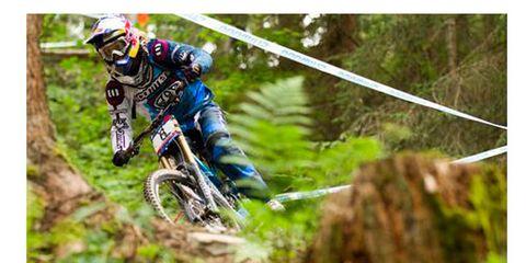 Motorcycle, Motorcycling, Motorcycle helmet, Sports equipment, Motorcycle racing, Soil, Helmet, Motocross, Sports gear, Adventure,
