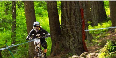 Helmet, Natural environment, Bicycle frame, Mountain bike, Bicycle helmet, Mountain biking, Downhill mountain biking, Bicycle wheel, Cross-country cycling, Sports equipment,