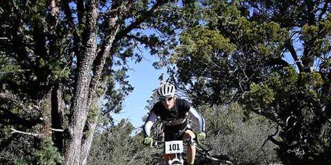 Tire, Wheel, Bicycle wheel, Bicycle frame, Mountain bike, Mountain biking, Cross-country cycling, Sports equipment, Bicycle, Downhill mountain biking,