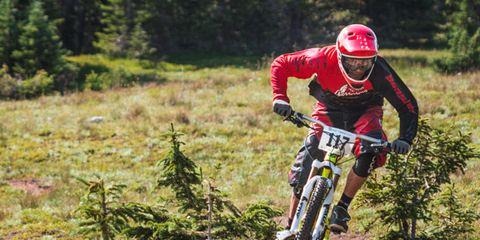 Helmet, Mountain bike, Plant community, Bicycle, Soil, Downhill mountain biking, Mountain biking, Endurance sports, Trail, Cycling shoe,
