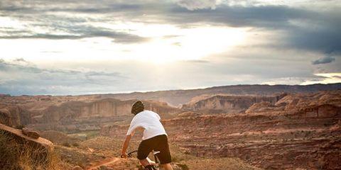 Sports equipment, Soil, Bicycle wheel, Mountain biking, Outdoor recreation, Mountain bike, Bicycle, Mountain, Bicycle frame, Cycle sport,
