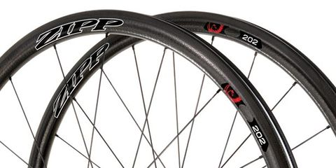 Bicycle tire, Wheel, Bicycle wheel rim, Bicycle part, Spoke, Rim, Bicycle accessory, Bicycle, Synthetic rubber, Line,