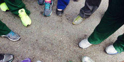 Clothing, Footwear, Human, Green, Leg, Shoe, Yellow, Human leg, People in nature, Athletic shoe,