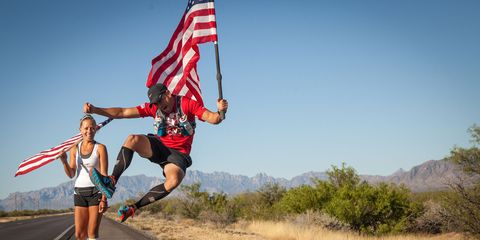 Knee, Athletic shoe, Playing sports, Active shorts, Sock, Flag, Adventure, Holiday, Shrubland, Running,