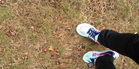 Leg, Grass, Shoe, Human leg, Athletic shoe, People in nature, Sneakers, Walking shoe, Groundcover, Running shoe,