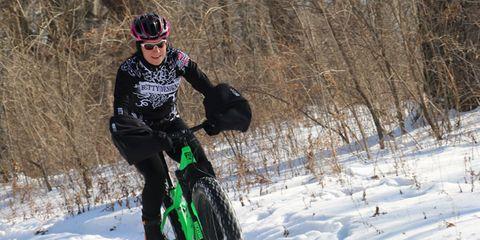 Bicycle wheel, Bicycle tire, Bicycle frame, Winter, Bicycle, Bicycle part, Bicycle wheel rim, Helmet, Sports equipment, Mountain bike,