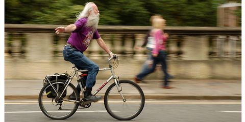 Grey-Haired Man Riding a Bike
