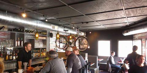 Barware, Ceiling, Chair, Tavern, Drinking establishment, Pub, Drink, Auto part, Alcoholic beverage, Spoke,