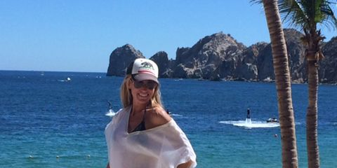 Body of water, Cap, Coastal and oceanic landforms, Water, Leisure, Tourism, Summer, Vacation, Ocean, Baseball cap,