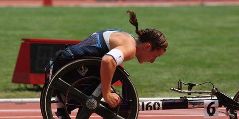 Tire, Wheel, Wheelchair sports, Bicycle tire, Bicycle wheel, Disabled sports, Wheelchair, Playing sports, Knee, Spoke,