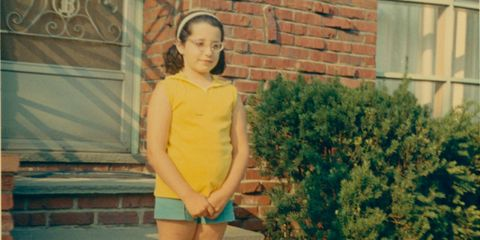 Age 10, in front of my grandparents' house in Pennsauken, New Jersey. I distinctly remember feeling fat at this age.