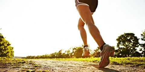 Grass, Human leg, Shoe, People in nature, Athletic shoe, Shorts, Sunlight, Knee, Active shorts, Sneakers,