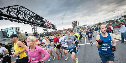 Footwear, Leg, People, Recreation, Endurance sports, Quadrathlon, Athletic shoe, Running, Crowd, Active shorts,
