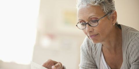 Older woman reading with glasses