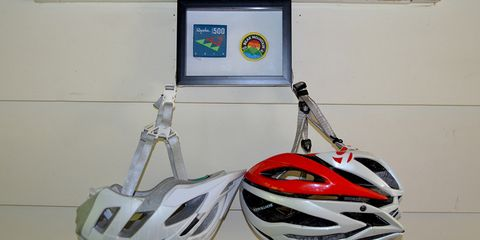 Bicycle helmet holder with patches in a shadow box display