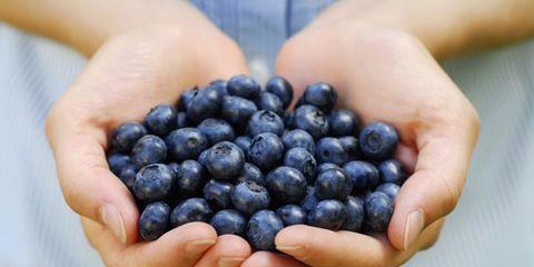 Finger, Blue, Skin, Fruit, Food, Produce, Seedless fruit, Ingredient, Berry, Natural foods,
