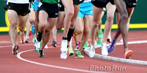 Footwear, Track and field athletics, Sport venue, Race track, Human leg, Athletic shoe, Running, Endurance sports, Shoe, Active shorts,