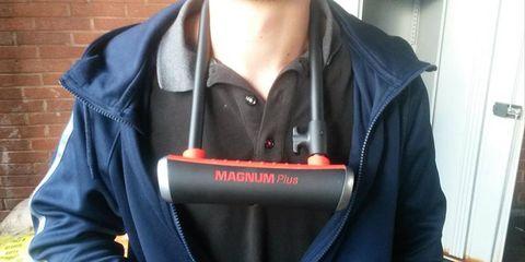 A bike lock around a man's neck