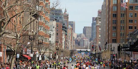 Runners head down Boylston Street toward the Boston Marathon finish line.