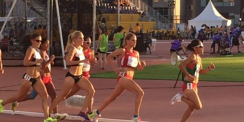 Track and field athletics, Sport venue, Race track, Athletic shoe, Sports uniform, Running, Sports, Athlete, Racing, Shorts,
