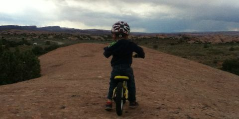 Little P Bonkoski rides a balance bike