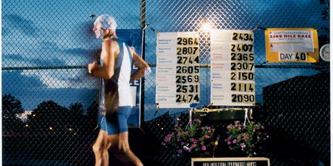 Human leg, Mesh, Wire fencing, Knee, Calf, Active shorts, Signage, Advertising, Chain-link fencing, Swimmer,