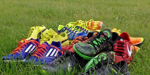 Grass, Carmine, Athletic shoe, Grassland, Cleat, Meadow, Outdoor shoe, Prairie, Walking shoe, American football cleat,