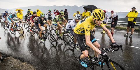 Chris Froome on the Stage 12 ascent to Plateau de Beille, in the pouring rain.