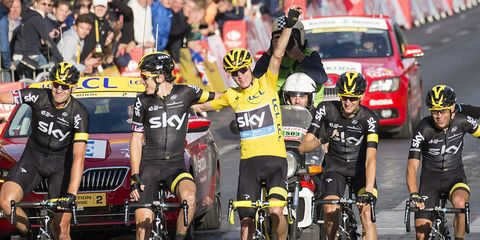 Chris Froome crosses the finish line during Stage 21 of the 2015 Tour de France