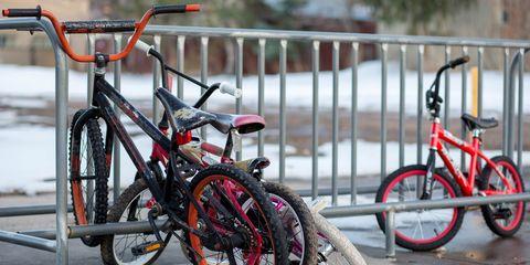 Kids bikes parked in a bike rack