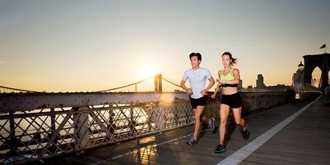 Human leg, Shorts, Athletic shoe, Bridge, Dusk, Sunset, Running, Evening, Walkway, Pedestrian,