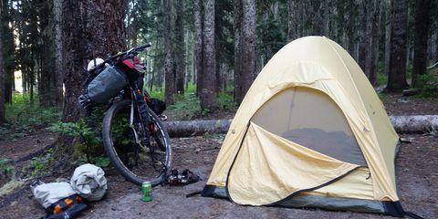 A bike next to a tent
