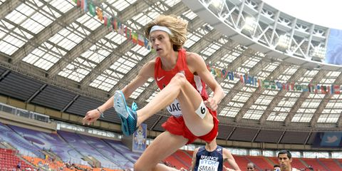 Sport venue, Sports uniform, Human leg, Jumping, Sportswear, Playing sports, Athletic shoe, Sports, Active shorts, Stadium,