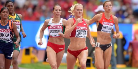 Sports uniform, Leg, Track and field athletics, Sport venue, Human leg, Race track, Sportswear, Shoe, Running, Athlete,