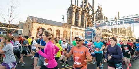 Footwear, Leg, Human leg, Athletic shoe, Physical fitness, Active shorts, Crowd, Shorts, Exercise, Running,