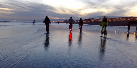 Finish your summer strong with a bike adventure like night beach riding!